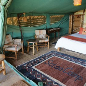 Satao Camp is a traditional camp in a shady grove along the Voi River in Tsavo East.