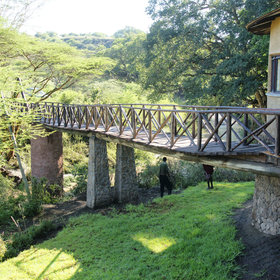 Access is via the national park itself and you reach the lodge over their private footbridge.