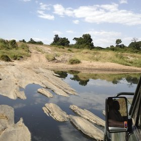 From the Ol Kiombo airstrip, you reach camp in a 4x4 vehicle, fording the seasonal Olare Orok river.