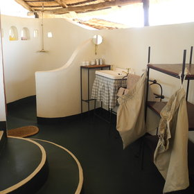 The en-suite bathrooms include a large shower, basin and flush toilet.