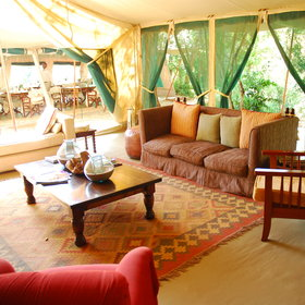 The dining tent is just a couple of steps away (watch our for monkeys overhead as you walk across)…