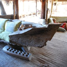 …incorporating fascinating ephemera, like this dugout canoe and 'bau' game…