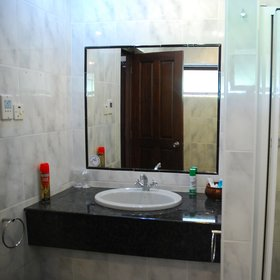The superior room bathrooms are plain and functional, with walk-in showers.