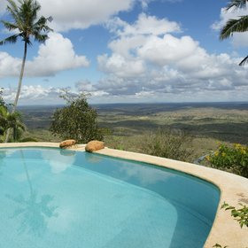 Between the two guest villas, Kutazama's fabulous pool sits in two tiers…