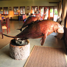 A large brass dugong greets you when entering the lounge…