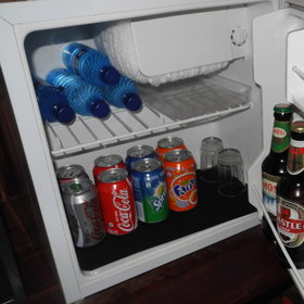 Comforts include a fridge with mini-bar…