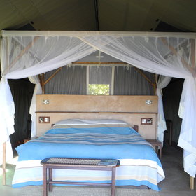 They have either a double or twin beds, all draped in mosquito netting…