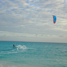 You can use the windy conditions for kite surfing…