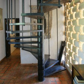 …a spiral staircase leads up…
