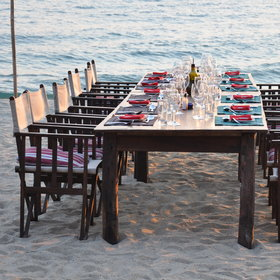 ..a long dining table, which will often be set out on the beach...