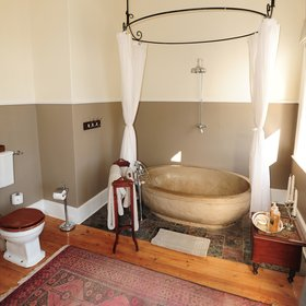 …while the third one boasts a massive oval stone bath.