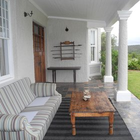 …a comfortably furnished veranda,…