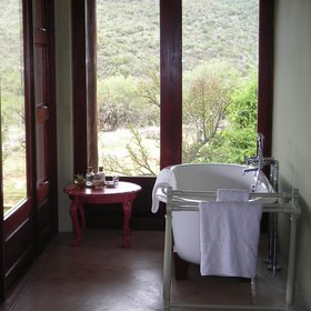 …and a spacious en suite bathroom, which features a bath,…