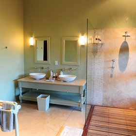 …twin wash basins, an indoor shower and a flush toilet.