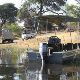 The game drive vehicles are reached by boat across the river and boat cruises are also offered.