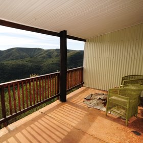 ...where Fench doors open out onto a private veranda overlooking the mountains.