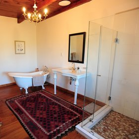 The bathroom here features a bath, wash basin,...