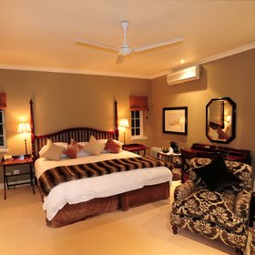 Each suite here has a spacious bedroom,…