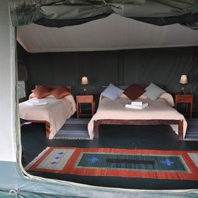 Each of the six tents has a double and a single bed…
