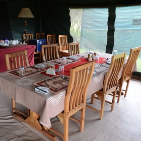 In the camp's shared main tent there is a dining area…