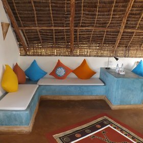 ...and they are decorated with white and sky blue walls and brightly coloured cushions.