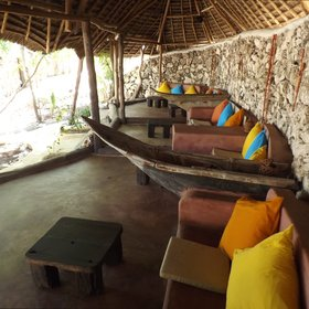 The seating area behind the pools is styled in the same way as the rest of the lodge.