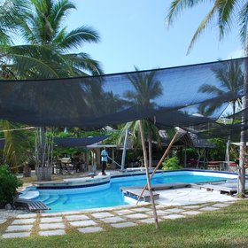 The pool is shaded by sun nets…