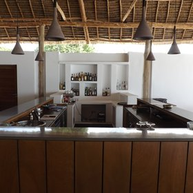 The main bar is on the left hand side of the bar, which looks out onto the swimming pool.