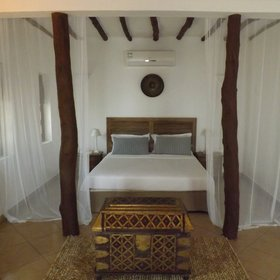 The rooms all have double beds and and swahili style chests.