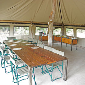…a large dining table where the communal meals are served,…