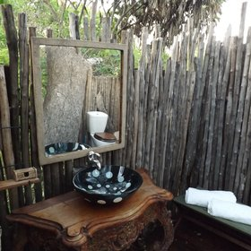 The en-suite bathroom comes complete with a sink, mirror and toiletries...