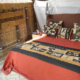 Mwaleshi has four comfortable chalets - where mosquito netting surrounds either queen-size...
