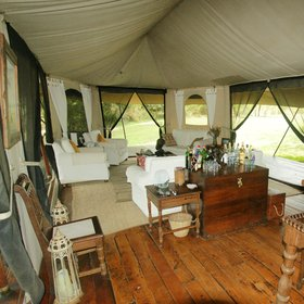 "The lounge and dining tent (or ""mess tent"") includes comfy seating…"
