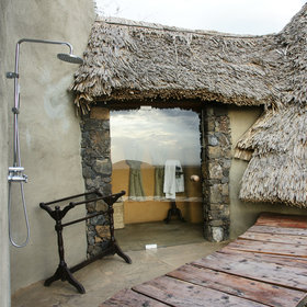 …and there are outdoor (as well as indoor) showers, cleverly secluded for privacy.