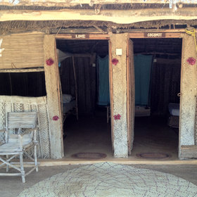Most of the guest accommodation is in wood-framed huts, walled with palm matting…
