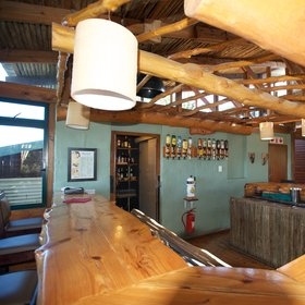 The central areas Kariega Main Lodge include a bar…