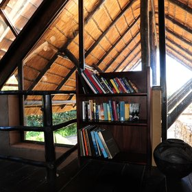 …and a mezzanine with a little book shelf...