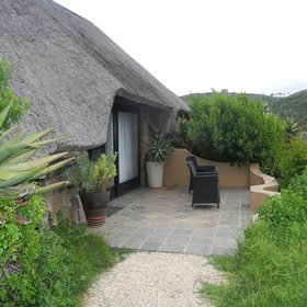 …the ten large thatched suites at Kariega River Lodge.