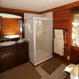 …which is equipped with a glass shower, a washbasin,…