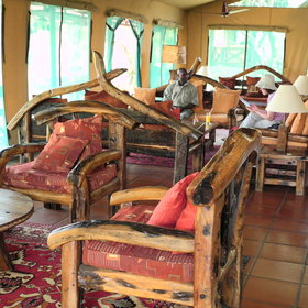 The lounge area has chunky sofas made from old reclaimed dhow wood...