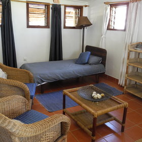 One of the rooms has a separate lounge with a day bed which can be used for a child.