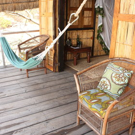 Each room has a private veranda with comfy chairs...