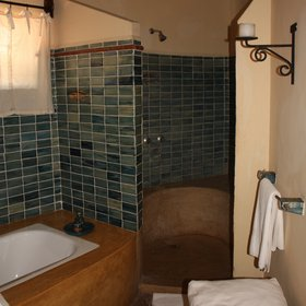 Each suite has an en-suite bathroom with a shower, a bath ,...