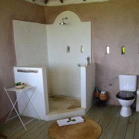 The ensuite, with a shower and flush loo is at the back of the room...