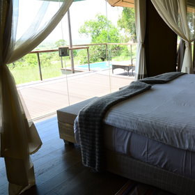 From the bedroom, through glass sliding doors is the veranda.