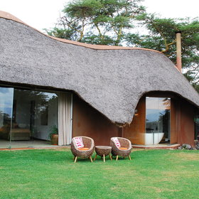 There's seating in front of each cottage, ideal for watching the sun rise over Mount Kenya