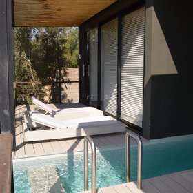 The Premier Suites also have their own plunge pool built into an expansive wooden deck.