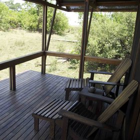 Each chalet has a balcony with a couple of wooden deckchairs.