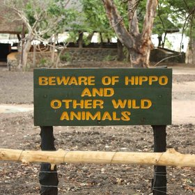 There are signs around the camp warning the guests of potential visitors...