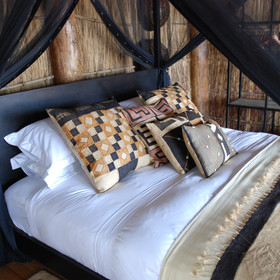 ... the bed covers and cushions are stylish and African.